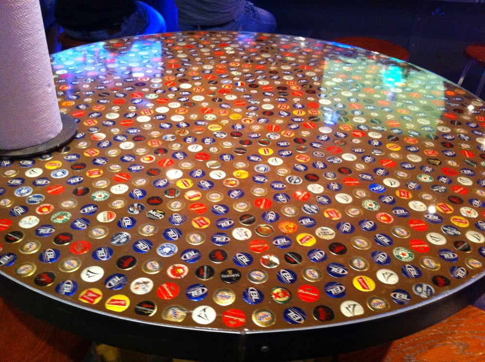 Inlaid Beer Bottle Cap Tables In Bar Area Yelp