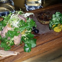 Starters: Smoked duck breast on left, Crispy pig cheeks on right