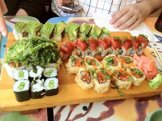 Sushi rolls include Tomodachi (deep fried spicy Tuna), Red ...
