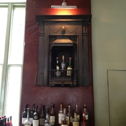 Very cool fireplace high up on the wall behind the bar