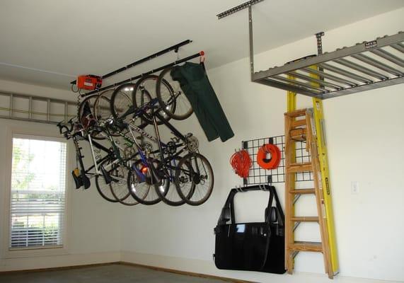 Electric Bike Hoist Wall Grid Organizer And Onrax Ceiling