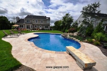 Swimming Pool Patio Made Of Walnut Travertine Paving