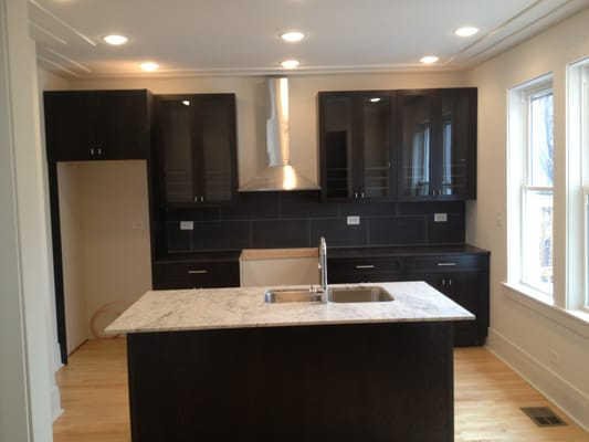 Ebony cabinets paired with a honed Quartz counter top, 1 ...