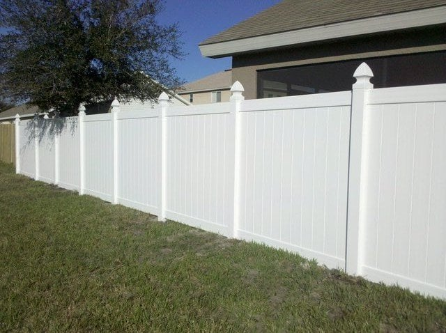White Vinyl Privacy Fence With Gothic Post Caps Yelp