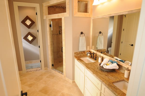 Travertine With Marble Inlays And Granite Countertops